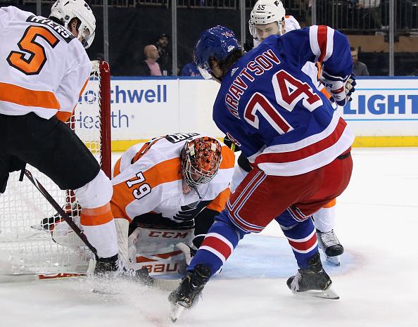 Involved in NHL Rumours, Vitali Kravtsov crowds the net during a preseason game; New York Rangers Black Aces.