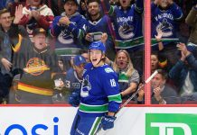 Jake Virtanen celebrates a goal.