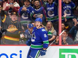 Jake Virtanen celebrates a goal.