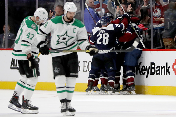 Mikko Rantanen #96 of the Colorado Avalanche is congratulated by his teammates after scoring what would be the winning goal against the Dallas Stars