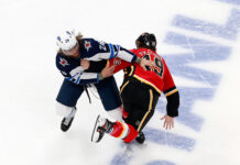 Blake Wheeler of the Winnipeg Jets and Matthew Tkachuk of the Calgary Flames fighting