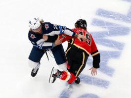 Blake Wheeler of the Winnipeg Jets and Matthew Tkachuk of the Calgary Flames fighting