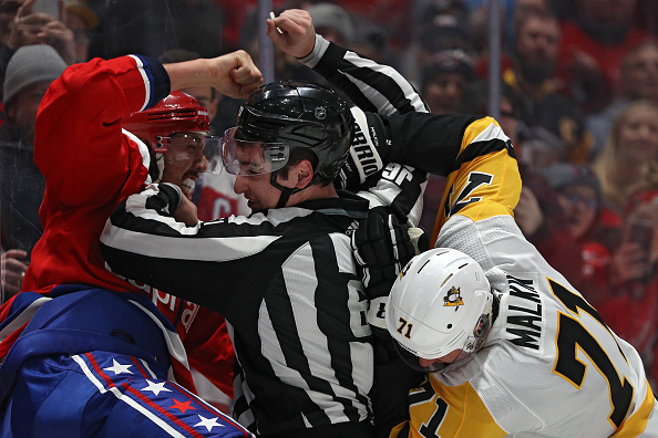Linesman-james-tobias-breaks-up-evgeni-malkin-of-the-pittsburgh-and-picture-id1208185624
