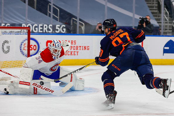 Edmonton-oilers-center-connor-mcdavid-shoots-the-puck-on-montreal-picture-id1232410936