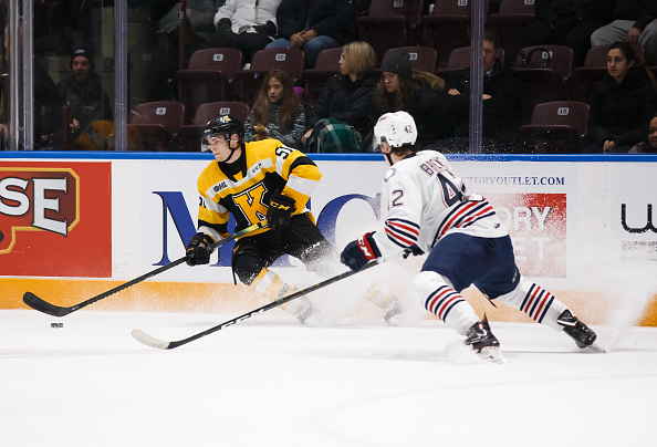 Shane-wright-of-the-kingston-frontenacs-skates-with-he-puck-during-an-picture-id1186704754