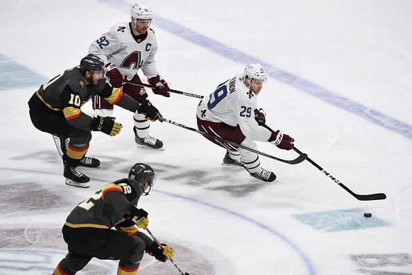 Colorado-avalanche-center-nathan-mackinnon-skates-after-the-puck-picture-id1312696552