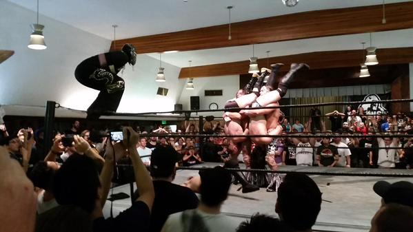 Super Dragon goes for a double Indytaker piledriver assist with the Young Bucks at BOLA '15 (Photo: pinterest.com)