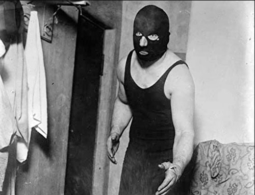 Mort Henderson as The Masked Marvel