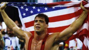 Kurt Angle with Olympic gold and USA flag