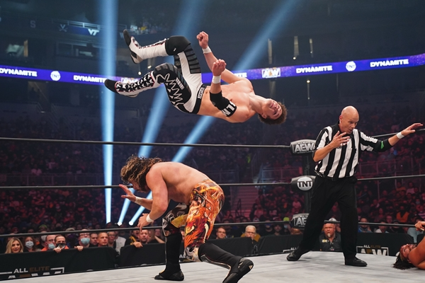 Dante Martin leaps over Kenny Omega