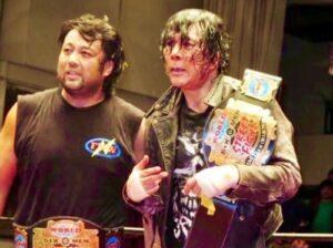 Hideki Hosaka with Atsushi Onita as trios champions