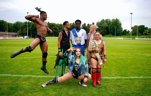 NXT UK talent with new Enfield Town FC kit