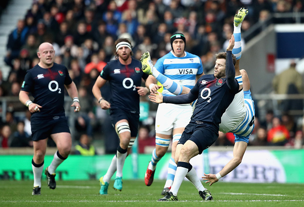 Leonardo Senatore of Argentina is taken out in the air by Elliot Daly of England during the Old Mutual Wealth Series match between England and Argentina at Twickenham Stadium on November 26, 2016 in London, England. (Photo by Julian Finney/Getty Images)