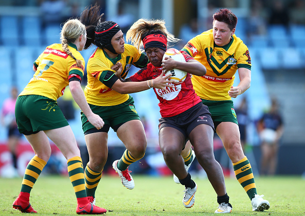 Canada Ravens player Tiera Reynolds is tackled by the Australian Jillaroos at Southern Cross Stadium