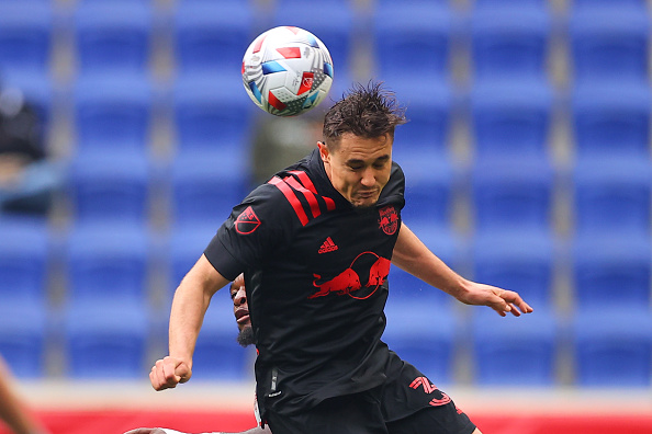 New York Red Bulls midfielder Aaron Long heads the ball playing against Toronto FC at Red Bull Arena