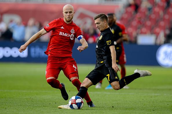 Trillum Cup rivalry season match where Pedro Santos of Columbus Crew SC kicked the ball away from Toronto FC player Michael Bradley