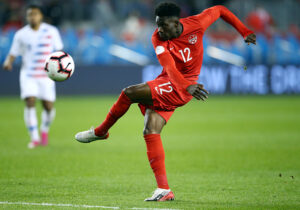 CanMNT player Alphonso Davies gets a shot on goal in the Concacaf Nations League