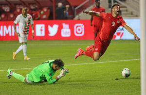 Suriname goalkeeper Warner Hahn gives up a penalty by fouling Canadian player Lucas Cavallini