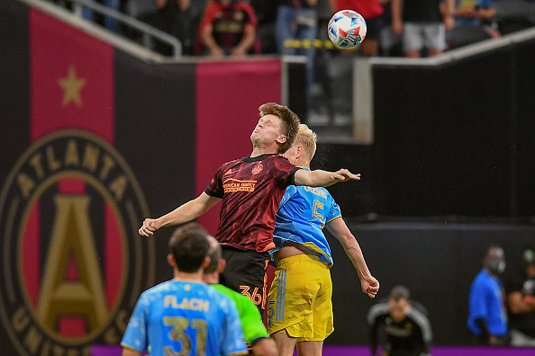 Atlanta United FC player Jackson Conway heads the ball on June 20th, 2021