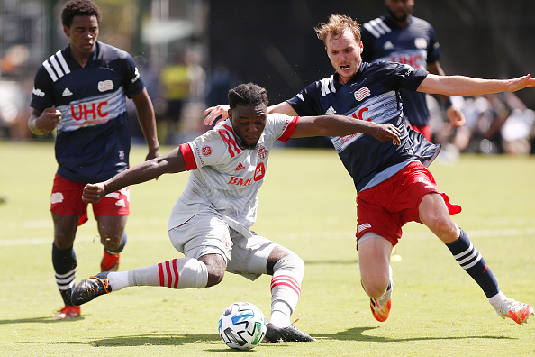 Ayo Akinola takes a shot on goal in the MLS is Back Tournament