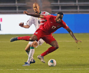 CanMNT player Cyle Larin tries to control the ball under pressure in Bridgeview, Illinois