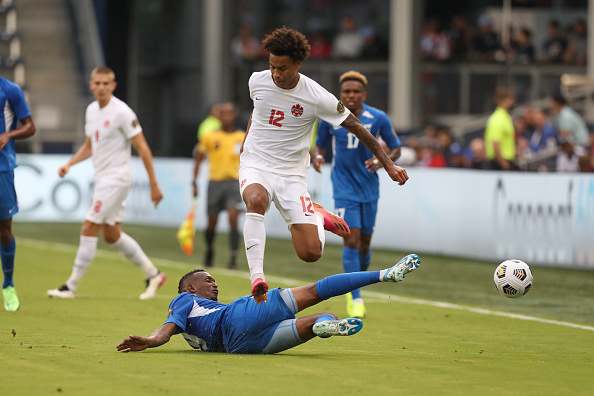CanMNT player Tajon Buchanan leaps over a Martinique player on July 11, 2021