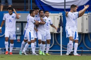 El Salvador celebrates scoring the first goal of the game against Trinidad & Tobago