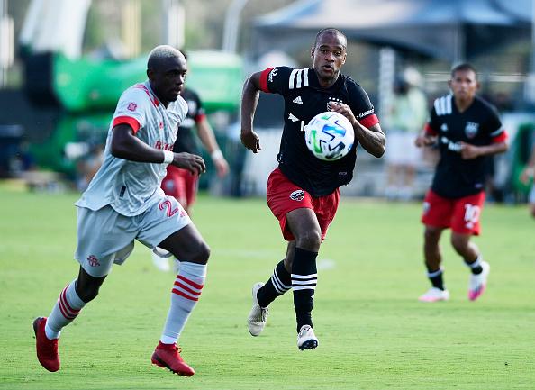 Ola Kamara and Chris Mavinga chases the ball in the MLS is Back Tournament