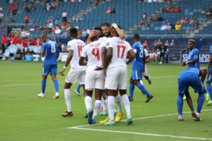 The CanMNT celebrates game-tying goal against Martinique