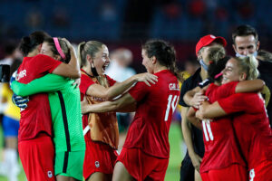 CanWNT celebrates a penalty shootout victory against Brazil at Miyagi Stadium