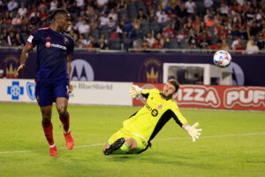 Toronto FC goalkeeper Alex Bono makes a save at Soldier Field