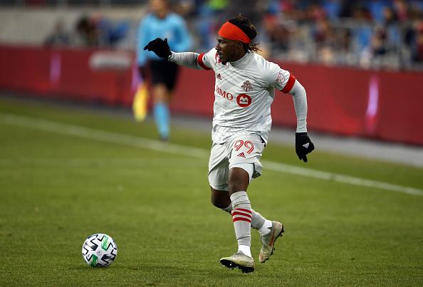 Toronto FC player Ifunanyachi Achara dribbles the ball against New York City FC