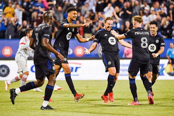 CF Montreal player Samuel Piette celebrates his goal with his teammates against Toronto FC