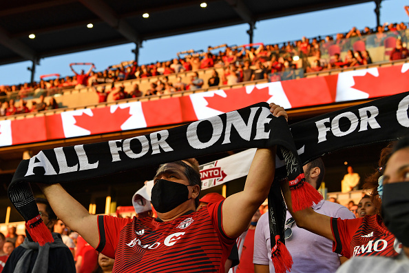Toronto FC fans hold up banners during the national anthem against the New England Revolution