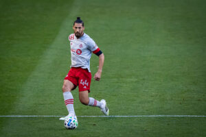 Toronto FC player Omar Gonzalez looks down the pitch to pass the ball at Red Bull Arena