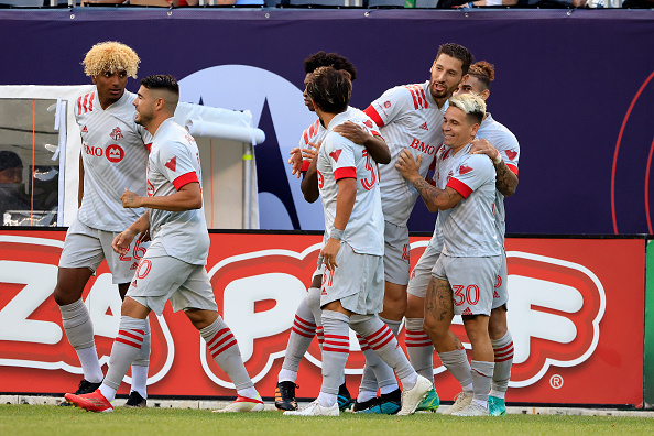 Toronto FC player Yeferson Soteldo celebrates with his team after scoring at Soldier Field