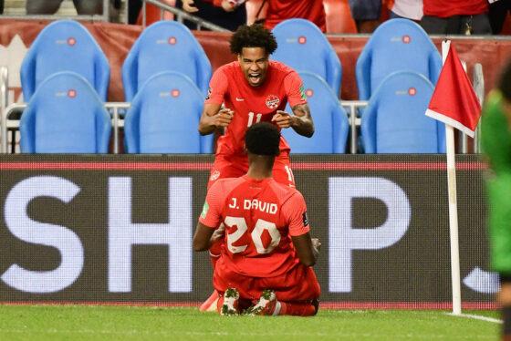 CanMNT player Tajon Buchanan celebrates his goal with Jonathan David against El Salvador