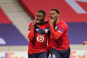Lille OSC teammate Timothy Weah celebrates Jonathan David's goal at Pierre Mauroy Stadium