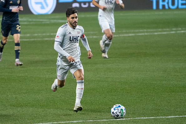 New England Revolution player Carles Gil dribbles the ball in the 2020 MLS Cup Playoffs in Chester, Pennsylvania