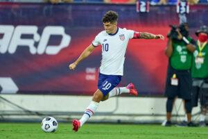 USA forward Christian Pulisic kicks the ball in Nashville, Tennessee