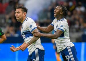 Vancouver Whitecaps FC player Erik Godoy celebrates his goal with Janio Bikel in Vancouver, British Columbia