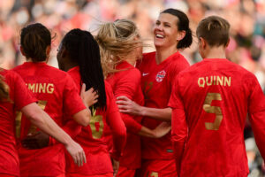 CanWNT captain Christine Sinclair celebrates her 189th goal with teammates