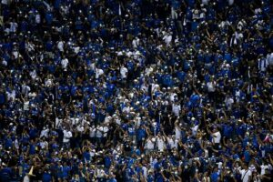 El Salvador fans turn on the lantern of their phones after a power cut at Cuscatlan Stadium
