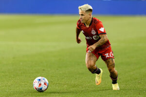 Toronto FC player Yeferson Soteldo runs with the ball against the New York Red Bulls
