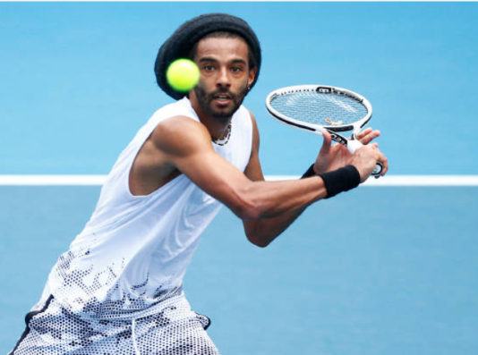 Dustin Brown in action on the Challenger Tour