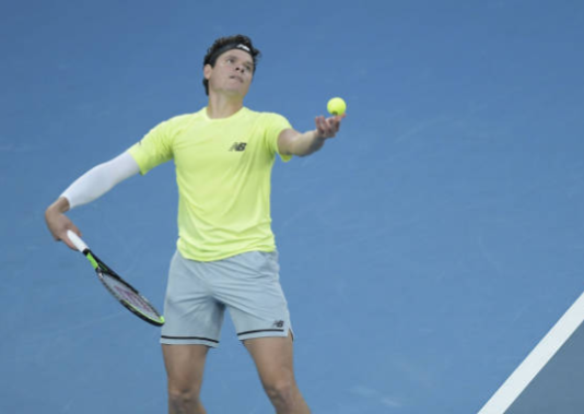 Milos Raonic in action at the Australian Open