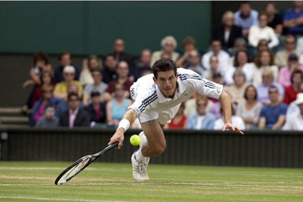 Tim Henman in action at Wimbledon in 2002