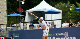 John Isner in action at the DraftKings All American Team Cup