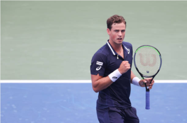 Vasek Pospisil celebrates winning a point at the US Open