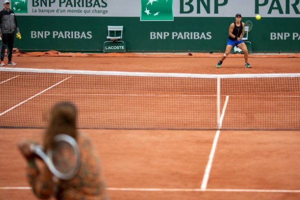 Ashleigh Barty and Naomi Osaka practicing at the French Open.